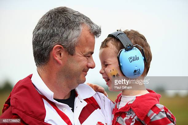David Luckman of England celebrates with his son Thomas after winning the Gold Medal with his partner Parag Patel in the Queens Prize Pairs Shooting...