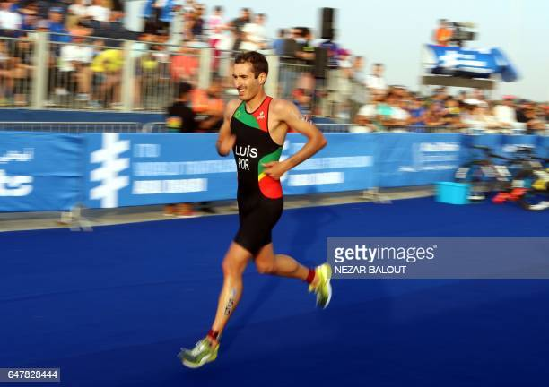 David Luis from Portugal competes in the ITU World Triathlon at the Yas Marina Circuit in Abu Dhabi on March 4 2017 / AFP PHOTO / NEZAR BALOUT
