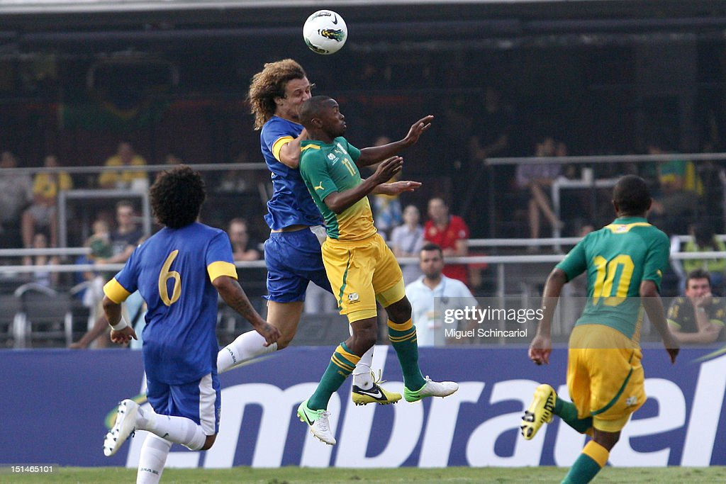 David Luis of Brazil fights for the ball with <a gi-track='captionPersonalityLinkClicked' href=/galleries/search?phrase=Bernard+Parker&family=editorial&specificpeople=1003236 ng-click='$event.stopPropagation()'>Bernard Parker</a> of South Africa a FIFA friendly match between Brazil and South Africa at Estadio Morumbí on September 07, 2012 in Sao Paulo, Brazil.