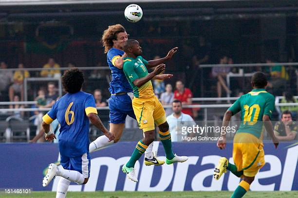 David Luis of Brazil fights for the ball with Bernard Parker of South Africa a FIFA friendly match between Brazil and South Africa at Estadio Morumbí...