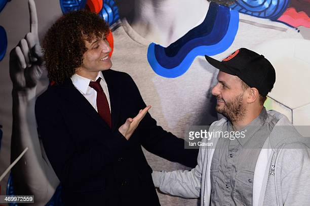 David Luiz and artist Ricardo AKN stand next to his artwork created by street artist Ricardo AKN and Photographer Danny Clinch unveiled at the Pepsi...