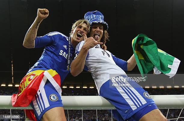 David Luiz and Fernando Torres of Chelsea celebrate after their victory in the UEFA Champions League Final between FC Bayern Muenchen and Chelsea at...