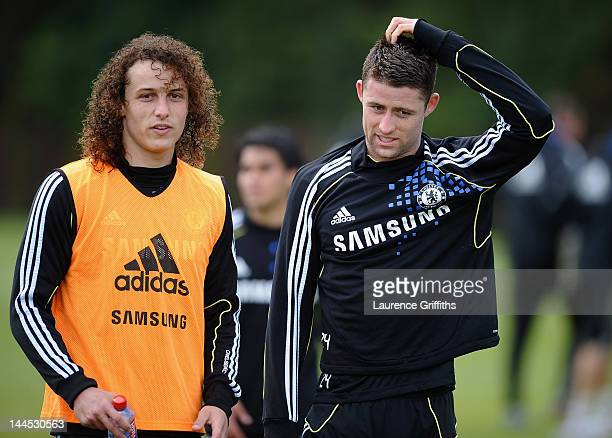 David Luiz and Gary Cahill of Chelsea walk off the field after training at Chelsea Training Ground on May 15 2012 in Cobham England
