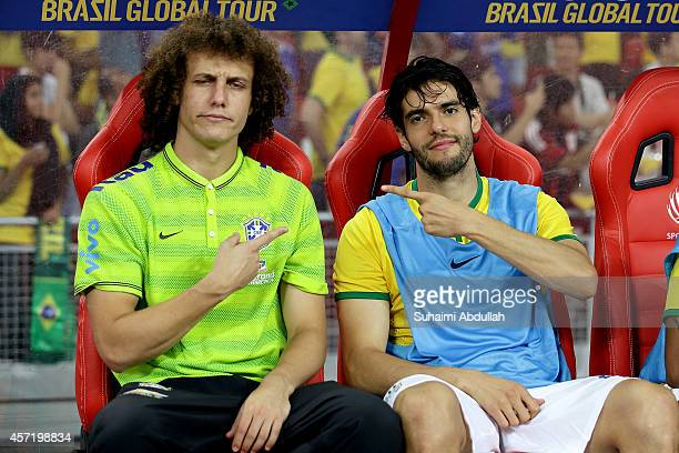 David Luiz and Kaka of Brazil gesture on the team bench during the international friendly match between Japan and Brazil at the National Stadium on...