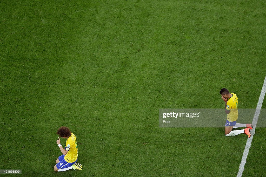 <a gi-track='captionPersonalityLinkClicked' href=/galleries/search?phrase=David+Luiz&family=editorial&specificpeople=4133397 ng-click='$event.stopPropagation()'>David Luiz</a> (L) and Luiz Gustavo of Brazil react after being defeated by Germany 7-1 during the 2014 FIFA World Cup Brazil Semi Final match between Brazil and Germany at Estadio Mineirao on July 8, 2014 in Belo Horizonte, Brazil.