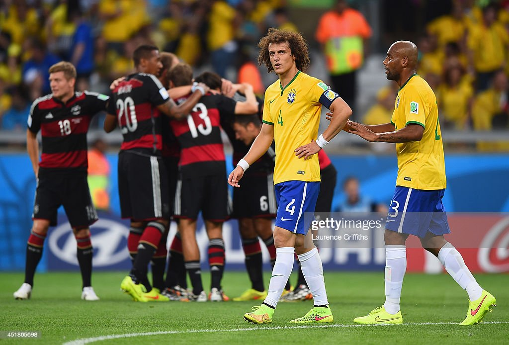 David Luiz and Maicon of Brazil react after allowing a goal during the 2014 FIFA World Cup Brazil Semi Final match between Brazil and Germany at Estadio Mineirao on July 8, 2014 in Belo Horizonte, Brazil.