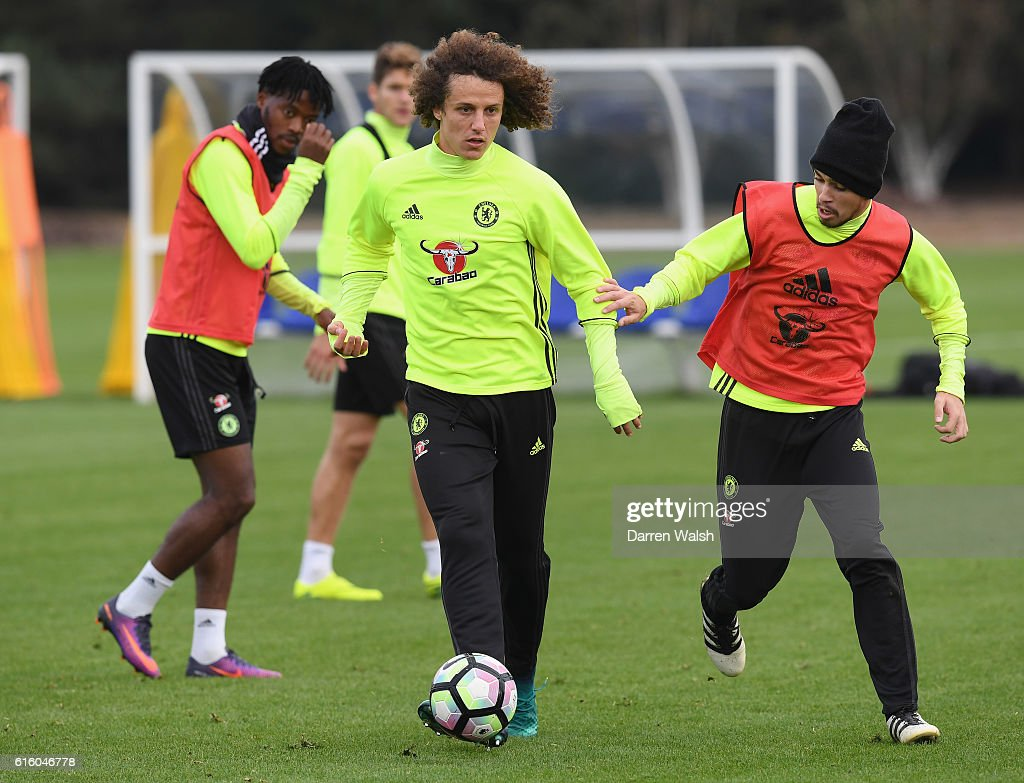 David Luiz and Oscar of Chelsea during a training session at Chelsea Training Ground on October 21, 2016 in Cobham, England.