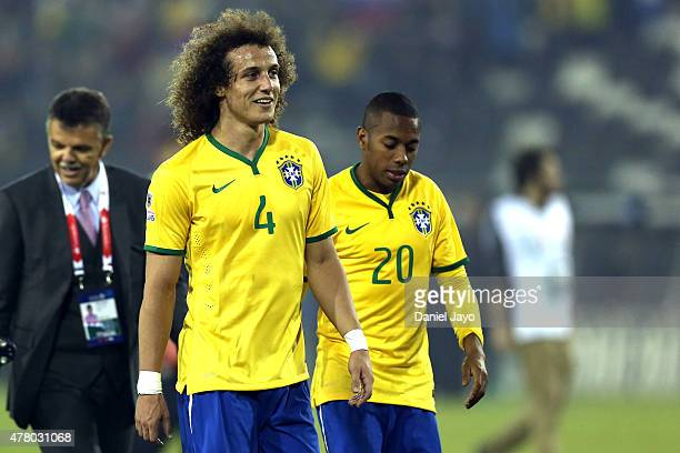 David Luiz and Robinho of Brazil of Brazil leave the field after the 2015 Copa America Chile Group C match between Brazil and Venezuela at Monumental...