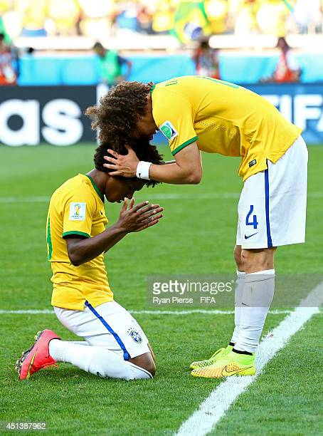 David Luiz and Willian of Brazil celebrate the win after the 2014 FIFA World Cup Brazil Round of 16 match between Brazil and Chile at Estadio...