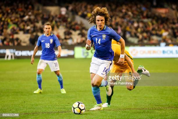 David Luiz Marinho competes with Mark Milligan during play as Brazil plays Australia in the Chevrolet Brasil Global Tour 2017 on June 13 2017 in...
