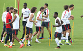 David Luiz Maxwell Scherrer Hatem Ben Arfa Serge Aurier Adrien Rabiot Benjamin Stambouli of PSG warm up during the first training session of the...