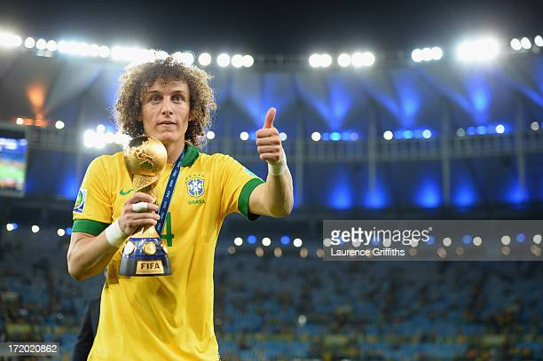 David Luiz of Brazil acknowledges the fans as he holds the FIFA Confederations Cup trophy after the FIFA Confederations Cup Brazil 2013 Final match...