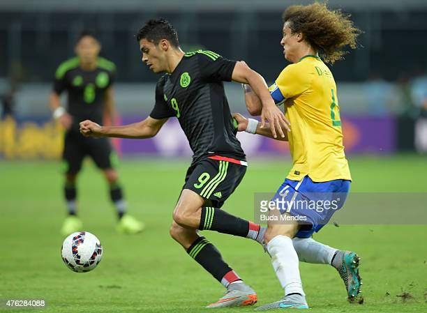 David Luiz of Brazil and Raúl Jiménez of Mexico compete for the ball during the International Friendly Match between Brazil and Mexico at Allianz...