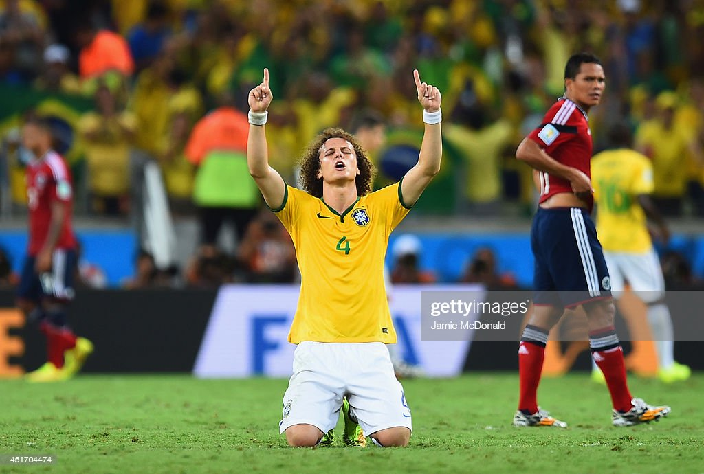 <a gi-track='captionPersonalityLinkClicked' href=/galleries/search?phrase=David+Luiz&family=editorial&specificpeople=4133397 ng-click='$event.stopPropagation()'>David Luiz</a> of Brazil celebrates after defeating Colombia 2-1 during the 2014 FIFA World Cup Brazil Quarter Final match between Brazil and Colombia at Castelao on July 4, 2014 in Fortaleza, Brazil.