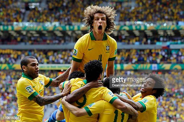 David Luiz of Brazil celebrates after Neymar scored his team's opening goal during the FIFA Confederations Cup Brazil 2013 Group A match between...