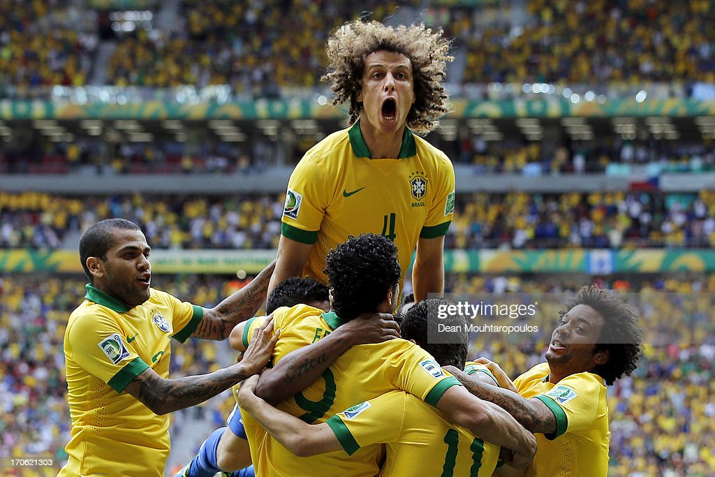 <a gi-track='captionPersonalityLinkClicked' href=/galleries/search?phrase=David+Luiz&family=editorial&specificpeople=4133397 ng-click='$event.stopPropagation()'>David Luiz</a> of Brazil celebrates after Neymar scored his team's opening goal during the FIFA Confederations Cup Brazil 2013 Group A match between Brazil and Japan at National Stadium on June 15, 2013 in Brasilia, Brazil.