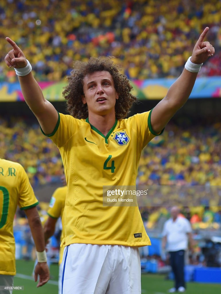 <a gi-track='captionPersonalityLinkClicked' href=/galleries/search?phrase=David+Luiz&family=editorial&specificpeople=4133397 ng-click='$event.stopPropagation()'>David Luiz</a> of Brazil celebrates scoring his team's first goal during the 2014 FIFA World Cup Brazil round of 16 match between Brazil and Chile at Estadio Mineirao on June 28, 2014 in Belo Horizonte, Brazil.