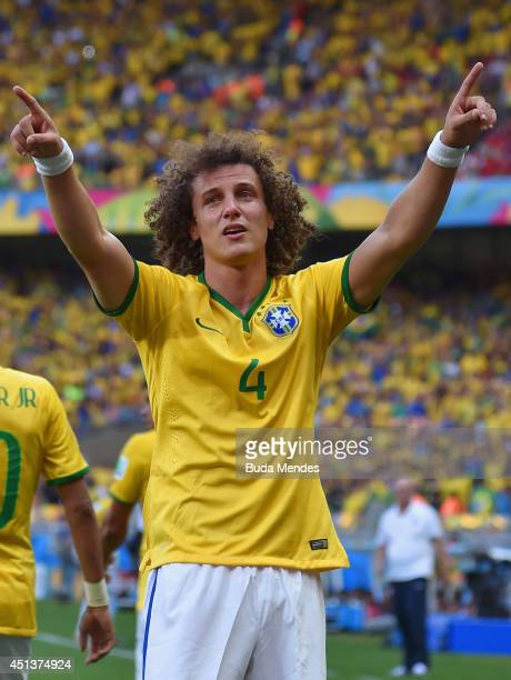 David Luiz of Brazil celebrates scoring his team's first goal during the 2014 FIFA World Cup Brazil round of 16 match between Brazil and Chile at...