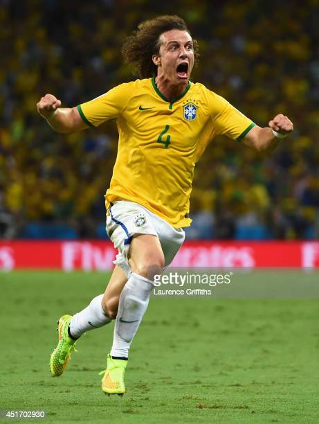 David Luiz of Brazil celebrates scoring his team's second goal during the 2014 FIFA World Cup Brazil Quarter Final match between Brazil and Colombia...