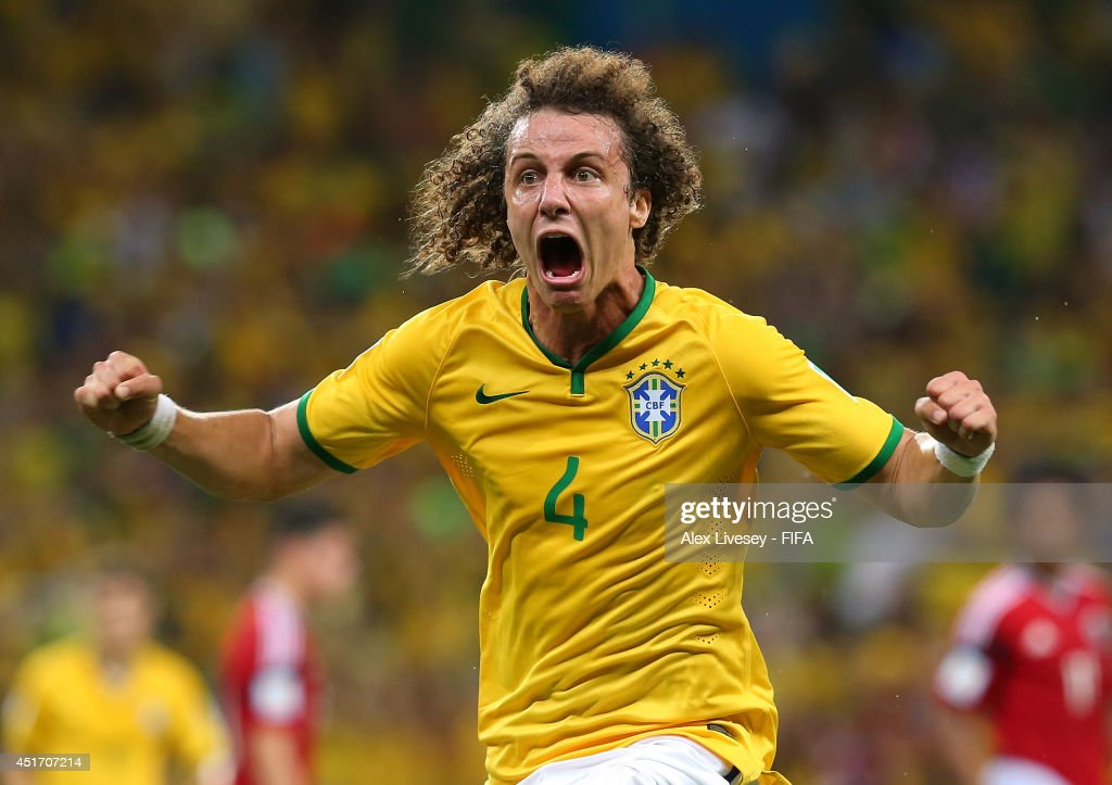 <a gi-track='captionPersonalityLinkClicked' href=/galleries/search?phrase=David+Luiz&family=editorial&specificpeople=4133397 ng-click='$event.stopPropagation()'>David Luiz</a> of Brazil celebrates scoring his team's second goal during the 2014 FIFA World Cup Brazil Quarter Final match between Brazil and Colombia at Estadio Castelao on July 4, 2014 in Fortaleza, Brazil.