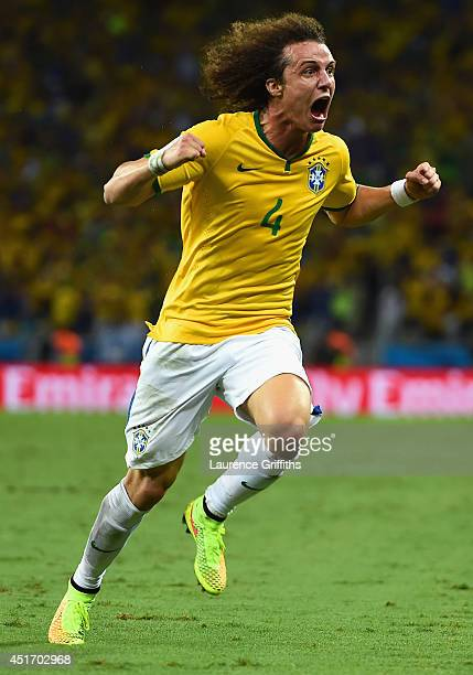 David Luiz of Brazil celebrates scoring his team's second goal on a free kick during the 2014 FIFA World Cup Brazil Quarter Final match between...