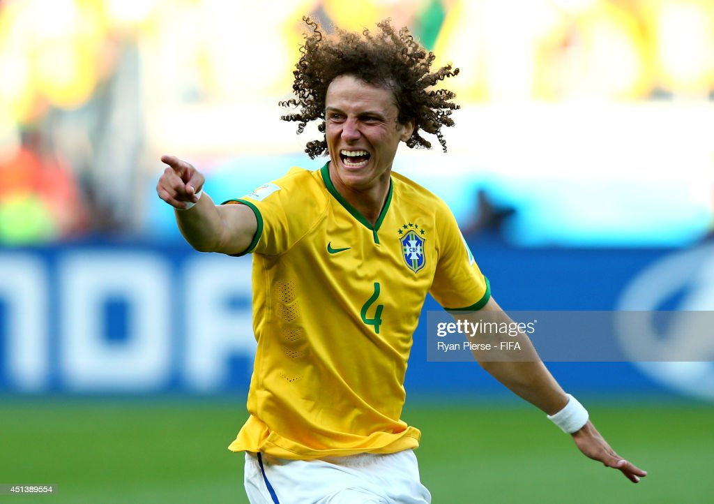 <a gi-track='captionPersonalityLinkClicked' href=/galleries/search?phrase=David+Luiz&family=editorial&specificpeople=4133397 ng-click='$event.stopPropagation()'>David Luiz</a> of Brazil celebrates winning by a penalty shooting after the 2014 FIFA World Cup Brazil Round of 16 match between Brazil and Chile at Estadio Mineirao on June 28, 2014 in Belo Horizonte, Brazil.
