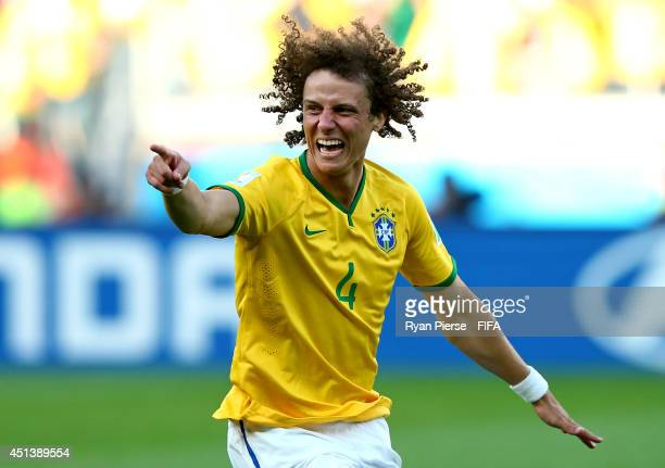 David Luiz of Brazil celebrates winning by a penalty shooting after the 2014 FIFA World Cup Brazil Round of 16 match between Brazil and Chile at...