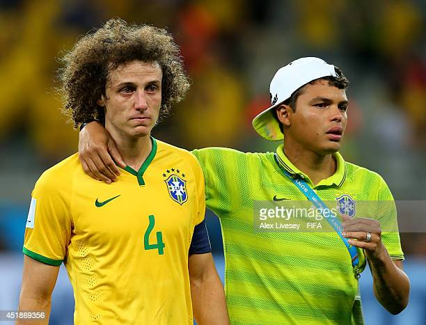 David Luiz of Brazil is consoled by Thiago Silva after the 2014 FIFA World Cup Brazil Semi Final match between Brazil and Germany at Estadio Mineirao...