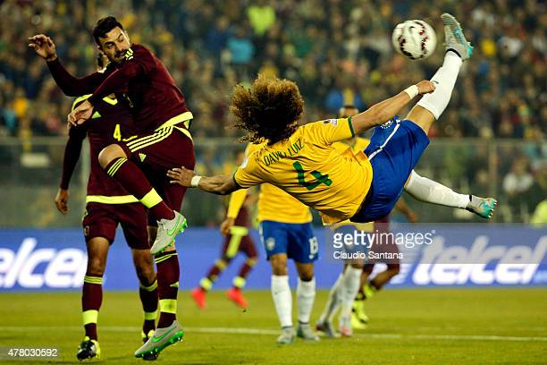David Luiz of Brazil jumps to kick the ball during the 2015 Copa America Chile Group C match between Brazil and Venezuela at Monumental David...