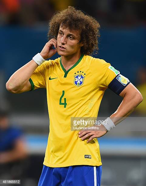 David Luiz of Brazil looks dejected during the 2014 FIFA World Cup Brazil Semi Final match between Brazil and Germany at Estadio Mineirao on July 8...