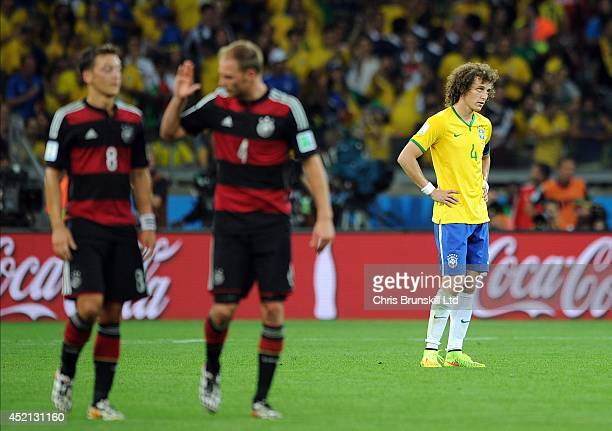 David Luiz of Brazil looks dejected during the 2014 FIFA World Cup Brazil Semi Final match between Brazil and Germany at Estadio Mineirao on July 08...