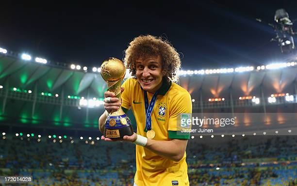 David Luiz of Brazil poses with the trophy at the end of the FIFA Confederations Cup Brazil 2013 Final match between Brazil and Spain at Maracana on...