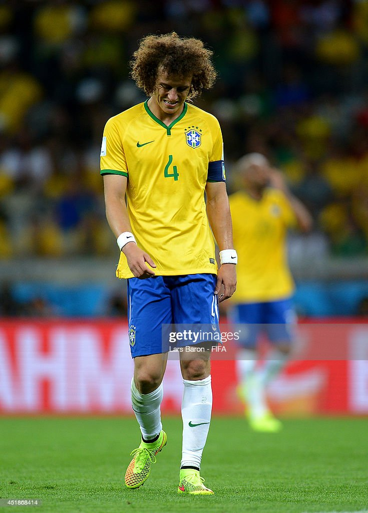 David Luiz of Brazil reacts after conceding the seventh goal to Germany during the 2014 FIFA World Cup Brazil Semi Final match between Brazil and Germany at Estadio Mineirao on July 8, 2014 in Belo Horizonte, Brazil.