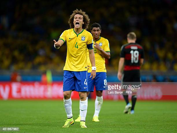 David Luiz of Brazil reacts during the 2014 FIFA World Cup Brazil Semi Final match between Brazil and Germany at Estadio Mineirao on July 8 2014 in...