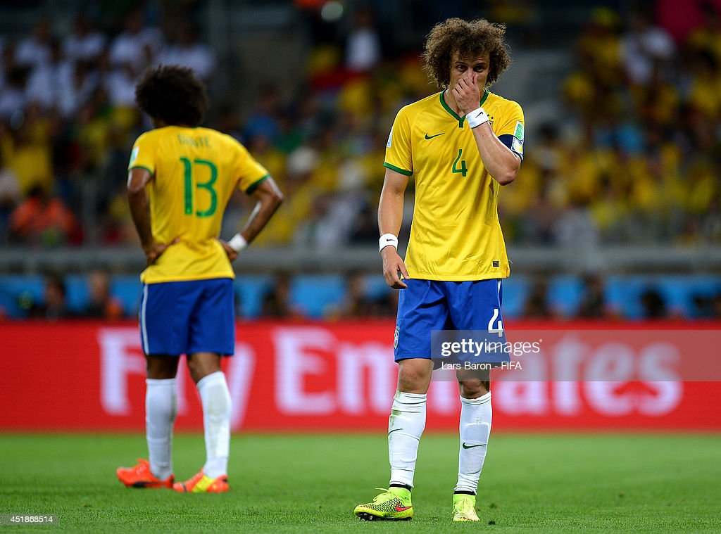 <a gi-track='captionPersonalityLinkClicked' href=/galleries/search?phrase=David+Luiz&family=editorial&specificpeople=4133397 ng-click='$event.stopPropagation()'>David Luiz</a> of Brazil reacts during the 2014 FIFA World Cup Brazil Semi Final match between Brazil and Germany at Estadio Mineirao on July 8, 2014 in Belo Horizonte, Brazil.