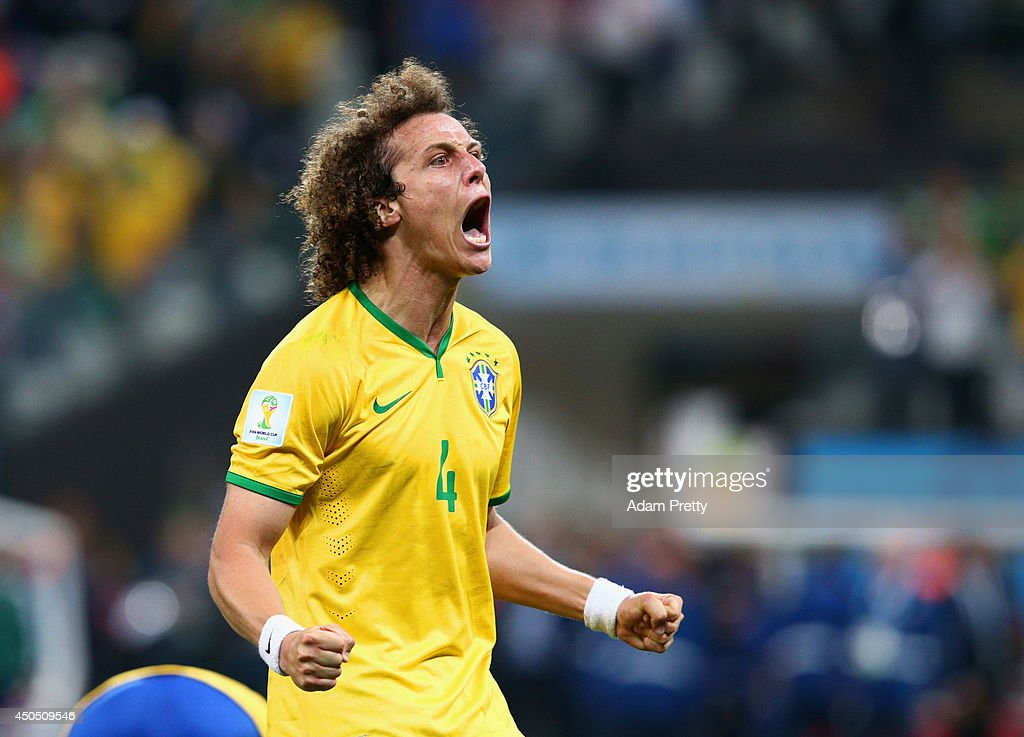 <a gi-track='captionPersonalityLinkClicked' href=/galleries/search?phrase=David+Luiz&family=editorial&specificpeople=4133397 ng-click='$event.stopPropagation()'>David Luiz</a> of Brazil reacts to a goal by Oscar (not pictured) in the second half during the 2014 FIFA World Cup Brazil Group A match between Brazil and Croatia at Arena de Sao Paulo on June 12, 2014 in Sao Paulo, Brazil.