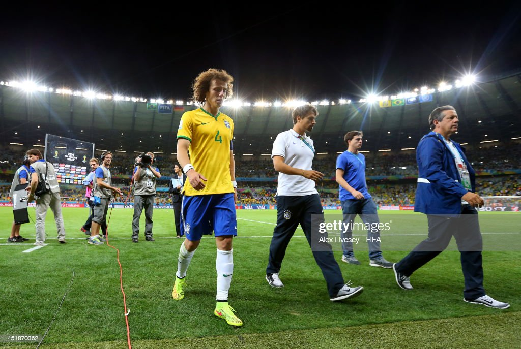 David Luiz of Brazil shows his dejection while walking off the pitch after the 1-7 defeat in the 2014 FIFA World Cup Brazil Semi Final match between Brazil and Germany at Estadio Mineirao on July 8, 2014 in Belo Horizonte, Brazil.