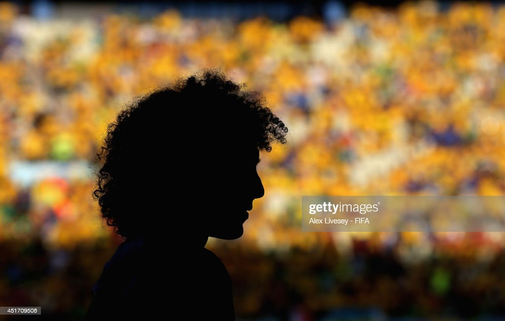 <a gi-track='captionPersonalityLinkClicked' href=/galleries/search?phrase=David+Luiz&family=editorial&specificpeople=4133397 ng-click='$event.stopPropagation()'>David Luiz</a> of Brazil warms up during the 2014 FIFA World Cup Brazil Quarter Final match between Brazil and Colombia at Estadio Castelao on July 4, 2014 in Fortaleza, Brazil.