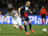 David Luiz of Chelsea and Alex Dias Da Costa of PSG in action during the UEFA Champions League quarter final match between Paris SaintGermain FC and...