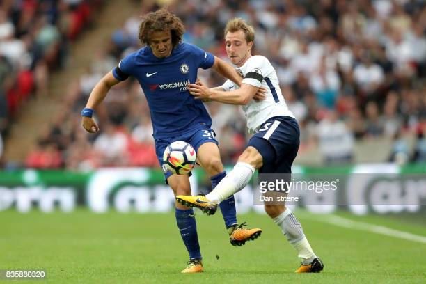 David Luiz of Chelsea and Christian Eriksen of Tottenham Hotspur battle for possession during the Premier League match between Tottenham Hotspur and...