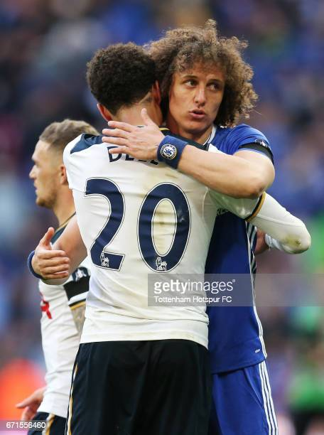 David Luiz of Chelsea and Dele Alli of Tottenham Hotspur hug after the match during The Emirates FA Cup SemiFinal between Chelsea and Tottenham...