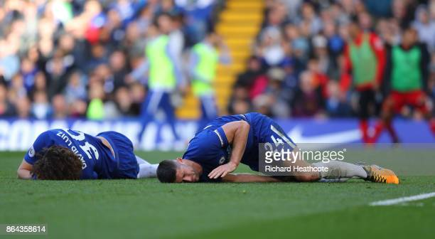 David Luiz of Chelsea and Gary Cahill of Chelsea lie injured during the Premier League match between Chelsea and Watford at Stamford Bridge on...