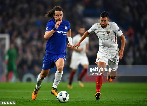 David Luiz of Chelsea and Kevin Strootman of AS Roma battle for possession during the UEFA Champions League group C match between Chelsea FC and AS...