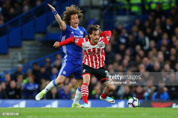 David Luiz of Chelsea and Manolo Gabbiadini of Southampton during the Premier League match between Chelsea and Southampton at Stamford Bridge on...