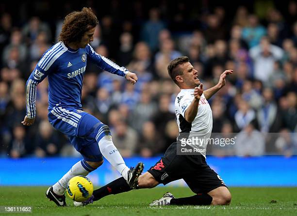 David Luiz of Chelsea and Orlando Sa of Fulham compete for the ball during the Barclays Premier League match between Chelsea and Fulham at Stamford...