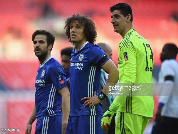 David Luiz of Chelsea and Thibaut Courtois of Chelsea look on during The Emirates FA Cup SemiFinal between Chelsea and Tottenham Hotspur at Wembley...