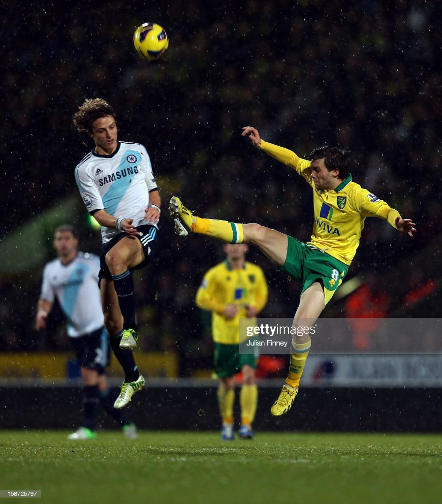 David Luiz of Chelsea battles with Jonathan Howson of Norwich City during the Barclays Premier League match between Norwich City and Chelsea at Carrow Road on December 26, 2012 in Norwich, England.