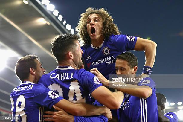 David Luiz of Chelsea celebrates after his team mate Diego Costa of Chelsea scores their sides second goal during the Premier League match between...