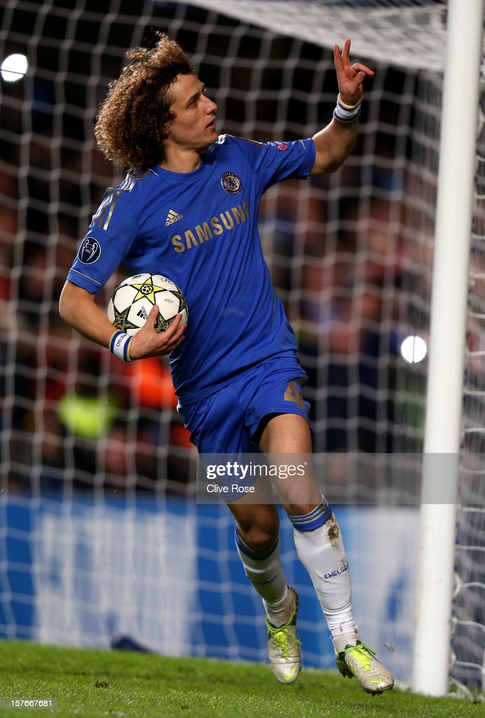 <a gi-track='captionPersonalityLinkClicked' href=/galleries/search?phrase=David+Luiz&family=editorial&specificpeople=4133397 ng-click='$event.stopPropagation()'>David Luiz</a> of Chelsea celebrates after scoring the opening goal from the npenalty spot during the UEFA Champions League group E match between Chelsea and FC Nordsjaelland at Stamford Bridge on December 5, 2012 in London, England.