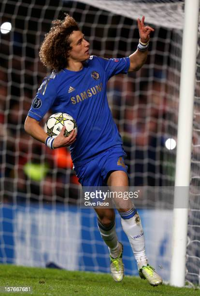 David Luiz of Chelsea celebrates after scoring the opening goal from the npenalty spot during the UEFA Champions League group E match between Chelsea...